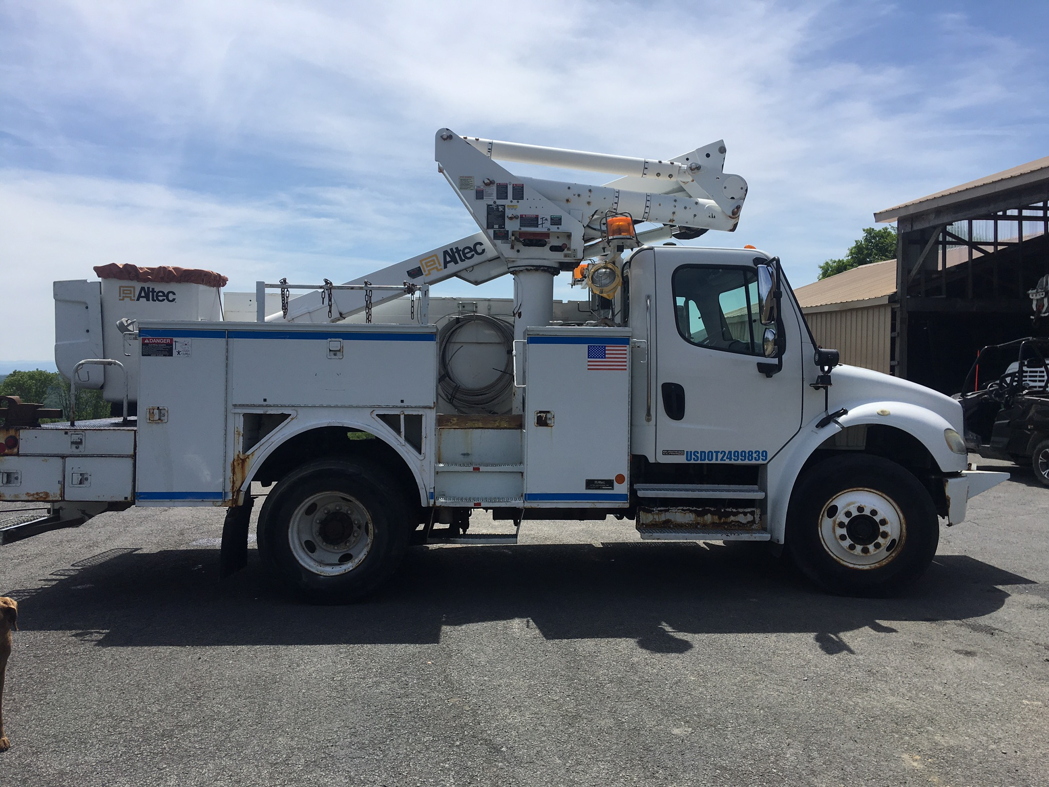 Miller and Miller utility pole truck